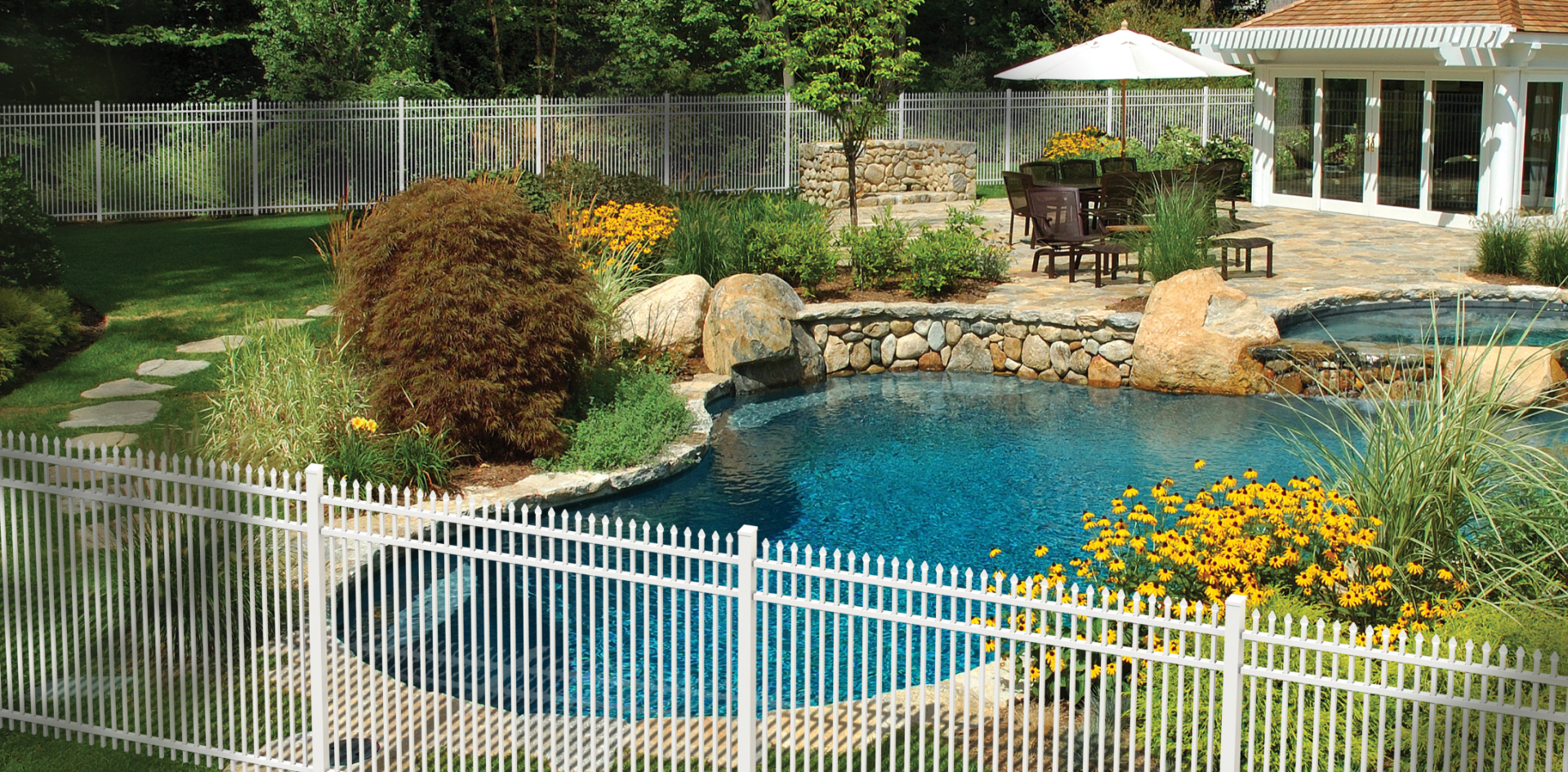 backyard residential pool with fence