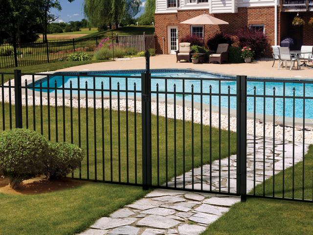 backyard black aluminum fence with residential pool