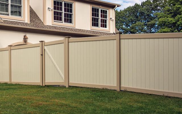 beige residential vinyl fence