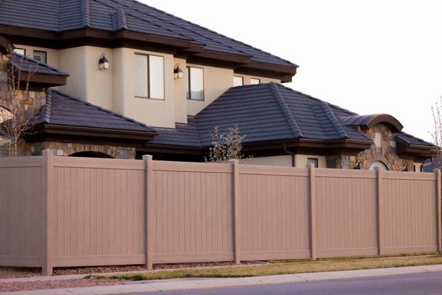 residential brown vinyl fence street view