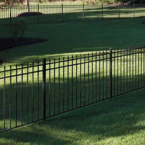 black aluminum fence in large yard