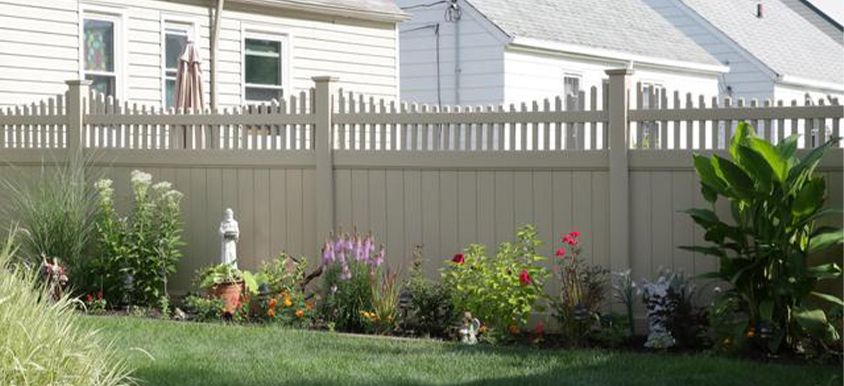 gray vinyl fence with flowers