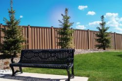 brown fence with black bench in backyard