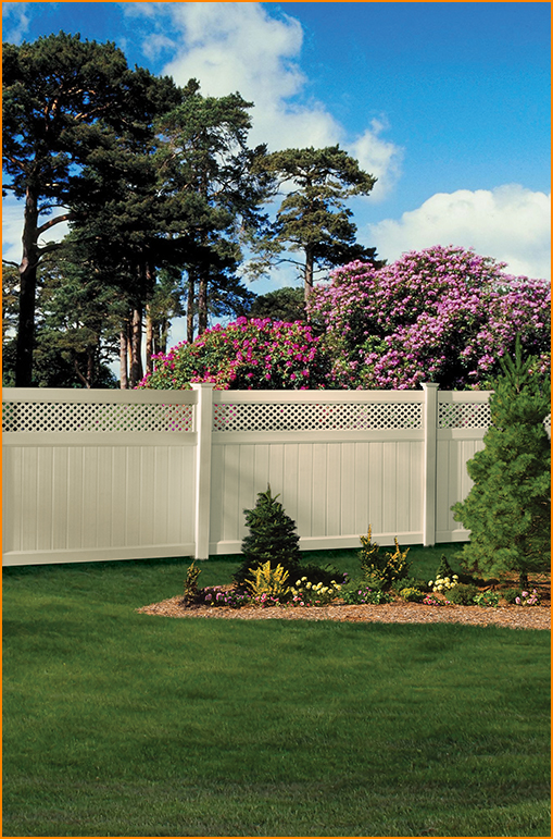side of backyard with white fence