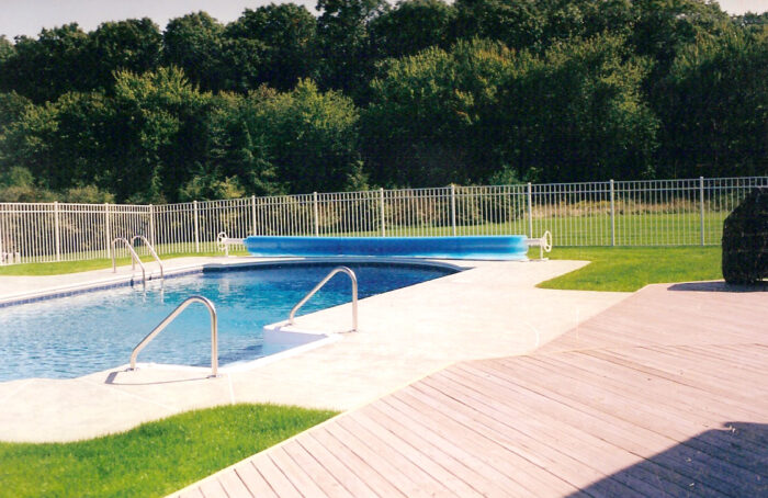 white aluminum fence in residential backyard with pool
