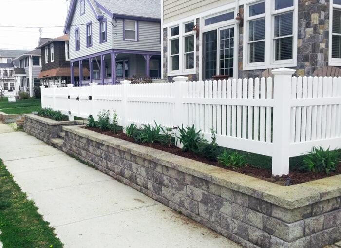 residential white vinyl fence sidewalk view